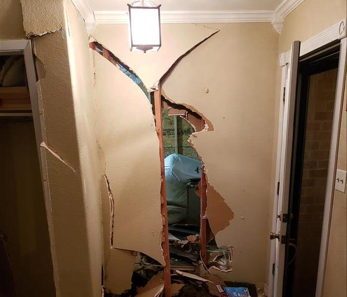 an entryway to a home with structural damage