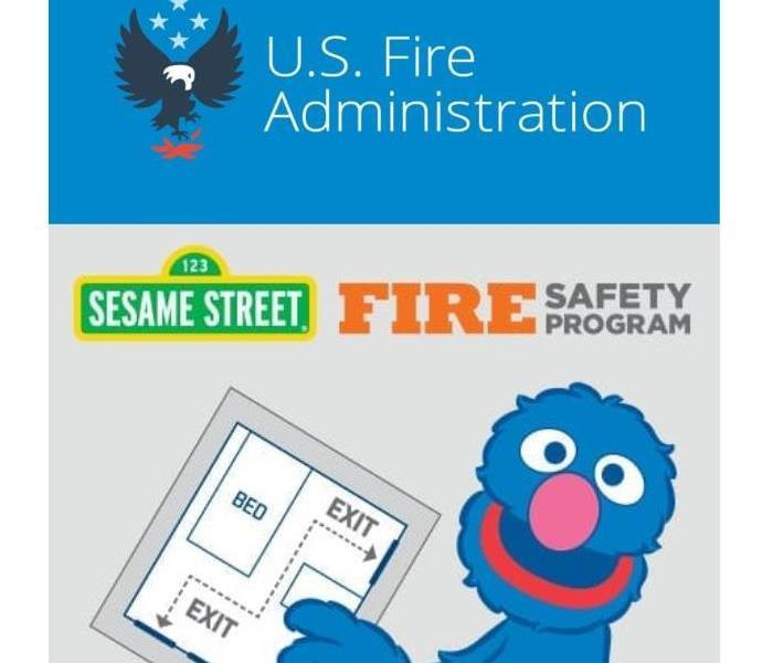 USFA logo and Grover of Sesame Street holding a fire exit plan