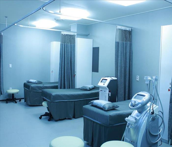 empty hospital ward with beds